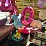 Jimmy with gifts and balloons